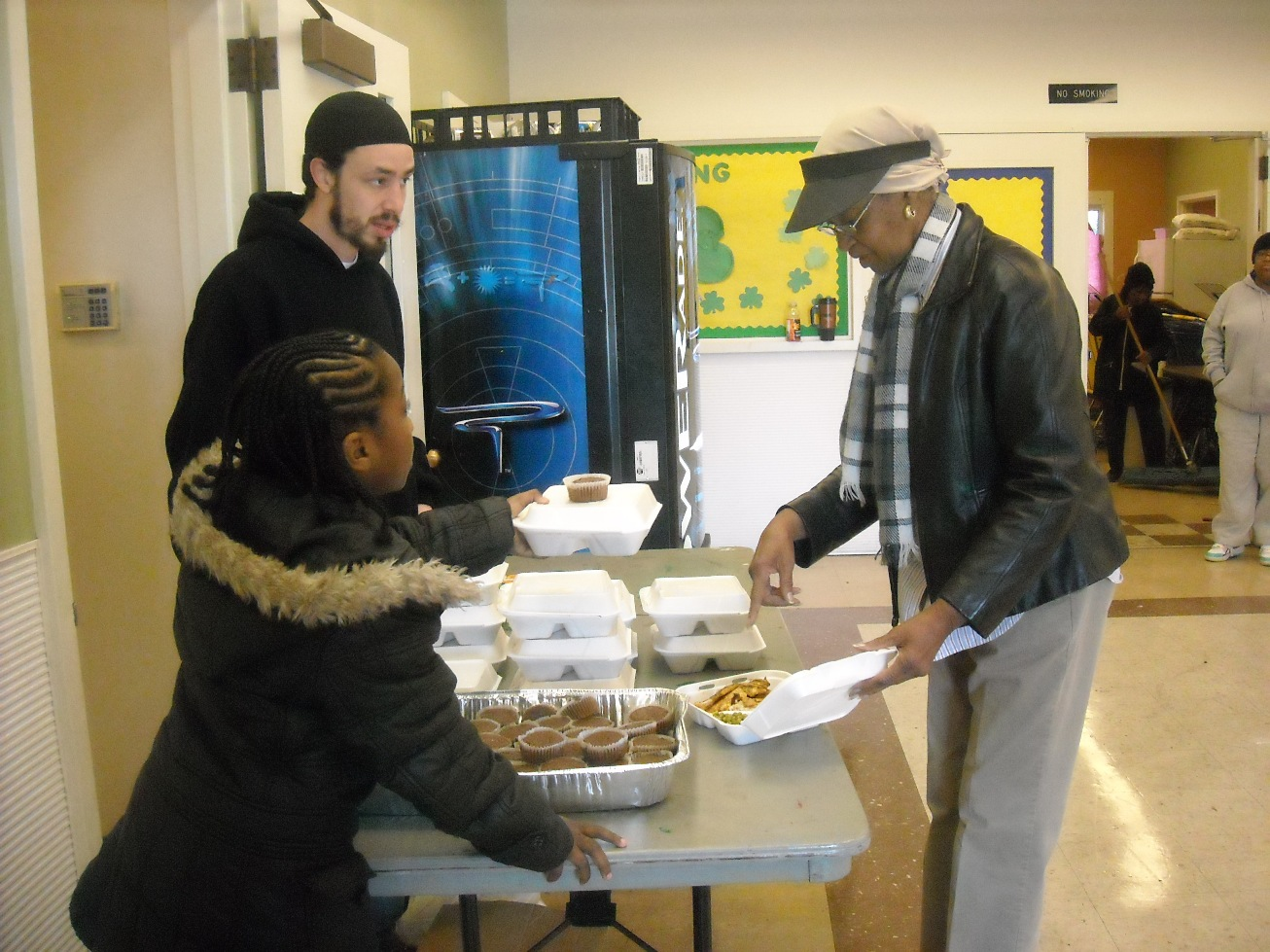 Distributing hot meals and muffins